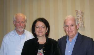 Professor Siobhan Garrigan with John Kelly (left) and Noel McCann of the ACI